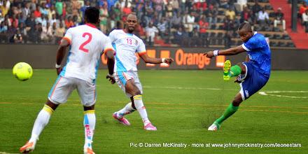 Photo: David Simbo strikes from just outside the box     [Leone Stars v DR Congo, 10 September 2014 (Pic © Darren McKinstry / www.johnnymckinstry.com)]