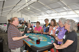 Photo: dealer at The Mill Casino teaching 21