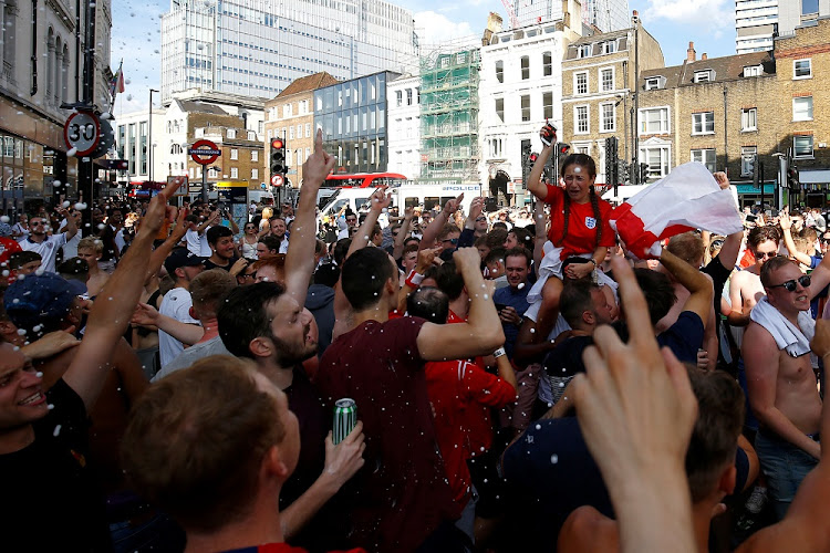 England fans celebrate after their team's World Cup victory over Sweden, in London, Britain, July 7 2018. Picture: REUTERS