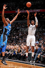 Photo: BROOKLYN, NY - JANUARY 28: Joe Johnson #7 of the Brooklyn Nets shoots a three-pointer against Moe Harkless #21 of the Orlando Magic on January 28, 2013 at the Barclays Center in the Brooklyn borough of New York City.  NOTE TO USER: User expressly acknowledges and agrees that, by downloading and or using this photograph, User is consenting to the terms and conditions of the Getty Images License Agreement. Mandatory Copyright Notice: Copyright 2013 NBAE  (Photo by Nathaniel S. Butler/NBAE via Getty Images)