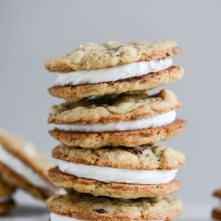 Chewy Black + White Chip Oatmeal Sandwich Cookies with Marshmallow Buttercream Filling.