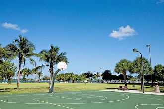 Photo: Enjoying the mild Miami weather with a friendly game of basketball at Margaret Pace Park, across the street from Paramount Bay
