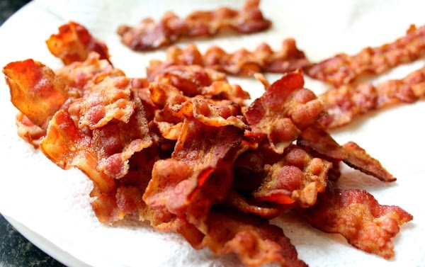 Crisp bacon on a white plate.