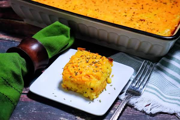 A Slice Of Corn Casserole On A Plate.