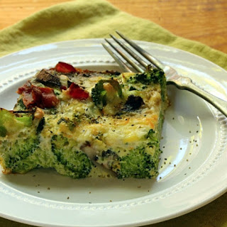 Egg And Two-cheese Breakfast Casserole With Broccoli, Mushrooms, Bacon And Herbs