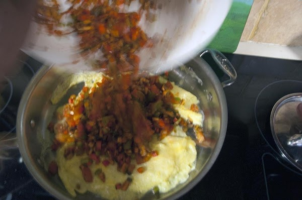 Add the vegetable mixture and use a wooden spoon to mix the veggies in...