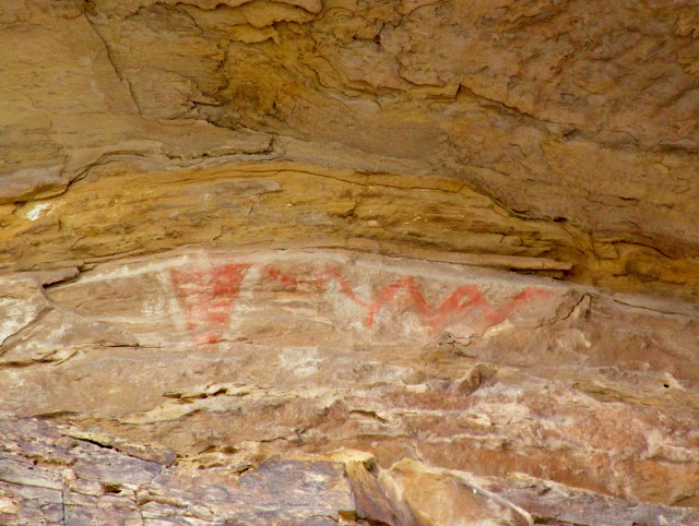 Faded red and white pictographs