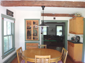 Photo: Dining room with table set for 4 persons