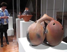 "Photo: Clay pot drums by Stephen Wright and triple ocarina (huaca) by Sharon Rowell. Exhibition of ceramic musical instruments at The Bascom Arts Center in Highlands, NC. The exhibit, curated by Barry Hall and Brian Ransom, features musical instruments created by ceramic artists from around the world, as featured in the book ""From Mud to Music"" by Barry Hall."