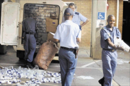 15 MARCH 2010 MONDAY: BREAK THROUGH: Polokwane police officers are registering an illegal cigarettes, street value of R100 000 which were confiscated from a van at Nirvana-Polokwane in Limpopo on Monday afternoon. Police  spokesperson Moatshe Ngoepe said seven people including two police officers, Inspector and constable who were combating crime were arrested after the tip-off. These two police officers were arrested after they demanded a certain amount from five suspects but police received a tip-off and arrested them at the scene. Ngoepe said two police officers  will be appeared before court soon while are still investigating the matter. Pic: ELIJAR MUSHIANA. 15/03/2010.