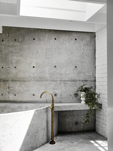 A concrete wet room - floors, walls, bath and side table - by Damian Oliveri was added to the original bathroom and is one of the couple's favourite rooms.