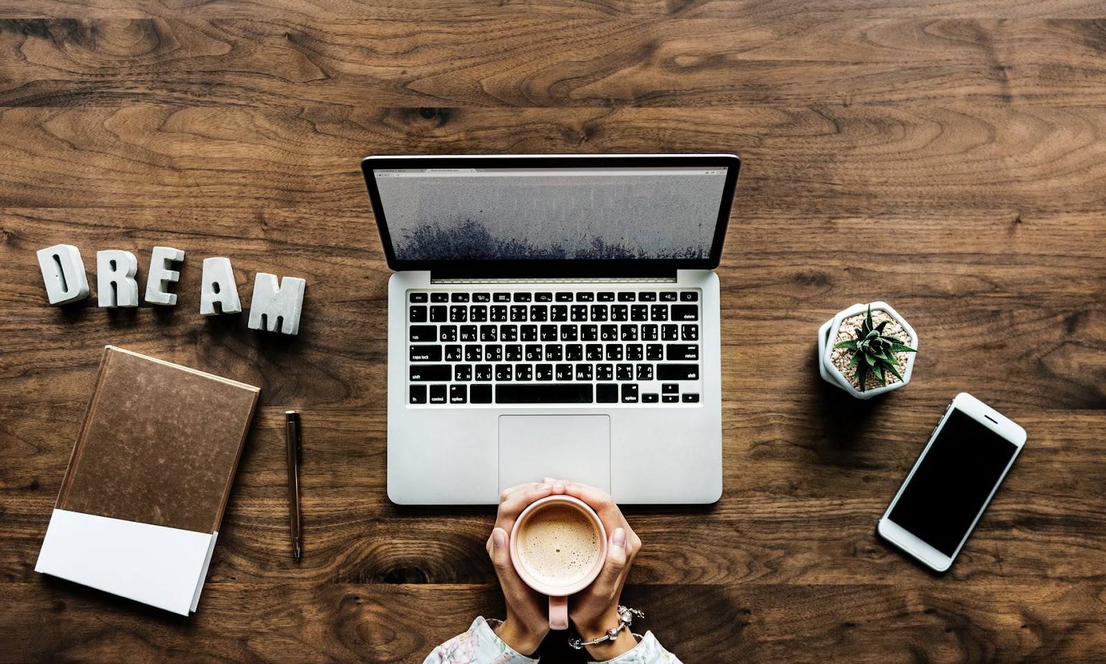 laptop, work area, signs of a marketing strategy for your small business