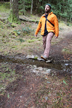 Photo: Totally non-posed picture of Ian crossing a creek crossing a trail.