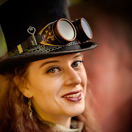 by Marco Bertamé - People Portraits of Women ( close up, smiling, woman, steampunk, goggles, headshot, lady, hat, portrait, key, smile,  )