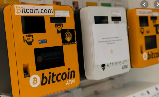 Three Bitcoin.com bitcoin ATMs in a row.