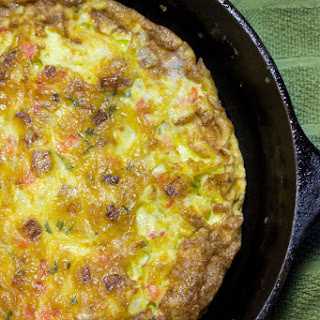 Italian Frittata With Sausage, Red Peppers, Potatoes, And Onions