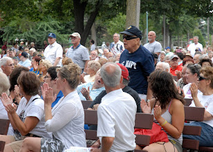 Photo: Veterans stood as their military service song was performed by the 34th Red Bull Infantry Division Band at the Minnesota State Fair's Military Appreciation Day Aug. 30, 2011 in St. Paul, Minn.