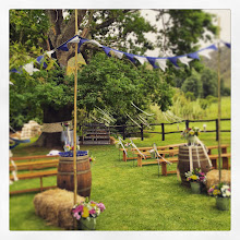 Photo: Country market feel for this decor, ribbons & bunting