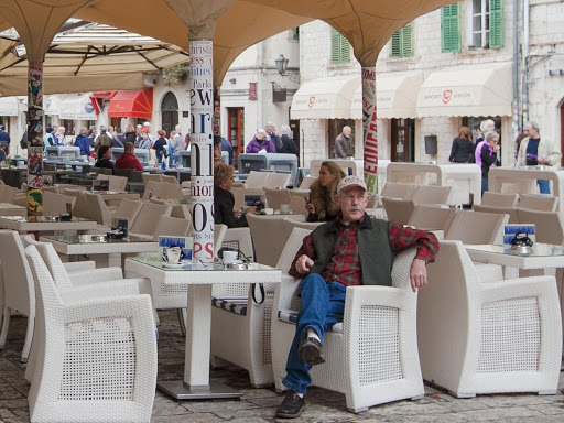 Kotor-cafe.jpg - A patron relaxes at Caffe Bar Forza in Kotor's Old Town.