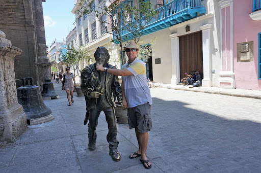 Havana-Gentleman-of-Paris.jpg -  A cruise visitor poses with El Caballero de Paris, a sculpture based on a well-known street person in 1950s Havana.