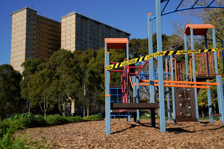 A playground is cordoned off with caution tape in front of a public housing tower, locked down in response to an outbreak of the coronavirus, in Melbourne, Australia, July 8 2020. Picture: REUTERS/SANDRA SANDERS