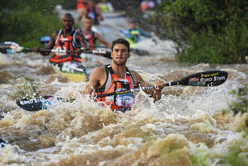 Andy Birkett set the pace on the first day of the Dusi Canoe Marathon on Thursday, with Sbonelo Khwela, background, hanging on to come home in second place. In the women's race, favourite Abby Solms secured a 12-minute lead. Picture: GAMEPLANE MEDIA/ANTHONY GROTE