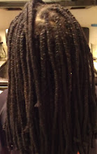 Photo: the back of her yarn braids