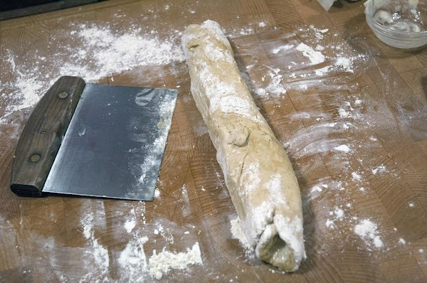 Roll the dough up, as you would dough for cinnamon buns.