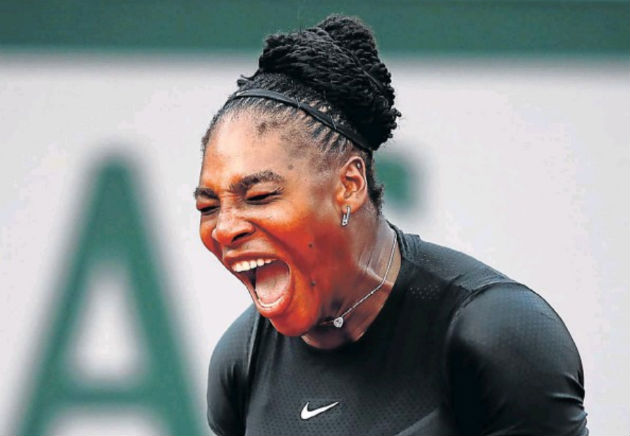 Serena Williams, of the United States, celebrates during the women's singles second round match against Ashleigh Barty of Australia at the French Open at Roland-Garros in Paris yesterday