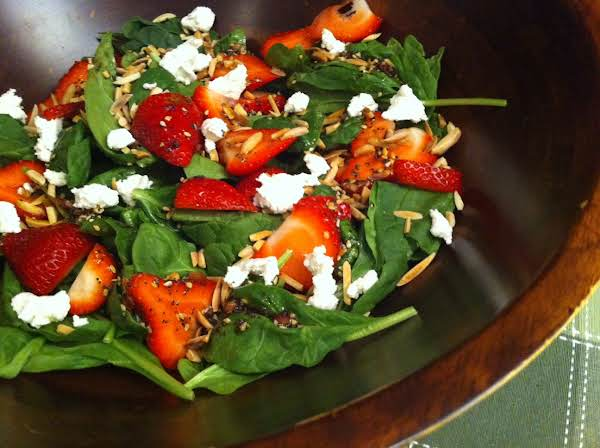 Spinach And Strawberries In A Wood Salad Bowl.