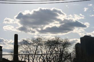 Photo: Clouds viewed looking under the Brooklyn Bridge.