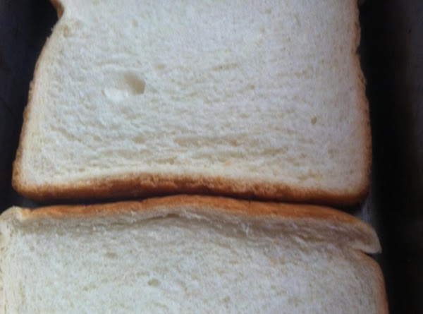 In a loaf pan put your two slices of bread (the heels work best)...