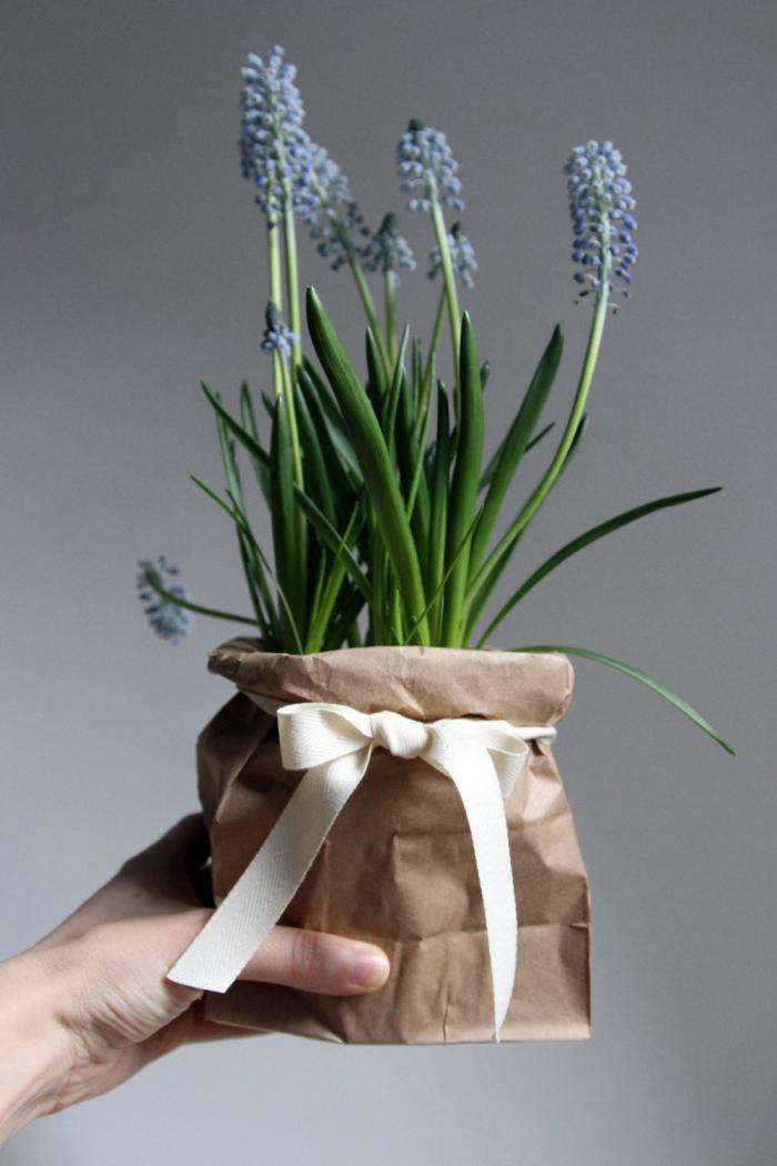 plants potted in paper bags DIY wedding table centerpiece