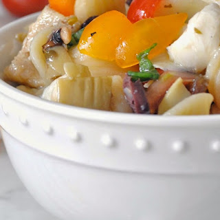 Mediterranean Pasta Salad with Marinated Artichokes, Olives, Fresh Mozzarella and Cherry Tomatoes