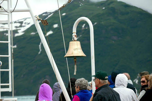 oosterdam-bell.jpg - A bell commemorates an early voyage on ms Oosterdam as passengers view the Hubbard Glacier.