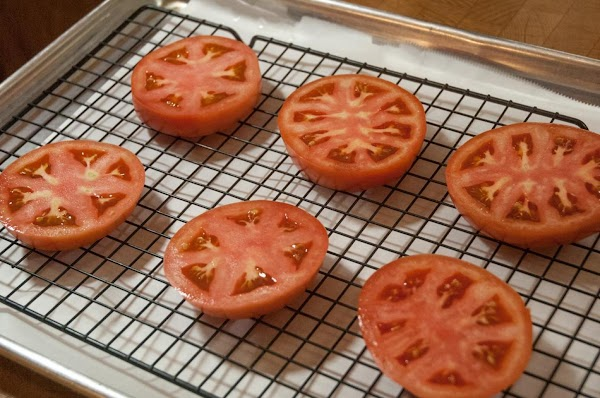 Lay the tomatoes in a parchment-lined baking sheet fitted with a wire rack.