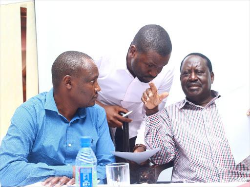 ODM party leader Raila Odinga (right) chats with secretary general Edwin Sifuna (C) and chairman John Mbandi.