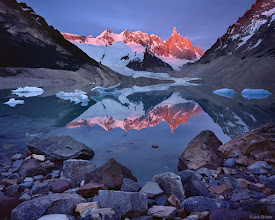 Photo: Sunrise alpenglow reflection of Cerro Torre, 10174 ft., in Lago Torre. In this perpetually windy region, calm lake reflections are a very rare treat, especially in a lake this large.<br><br>The enormous scale of these mountains is difficult to comprehend; consider that Cerro Torre towers 7,000 feet above this lake!  Parque Nacional Los Glaciares, Argentina - November.
