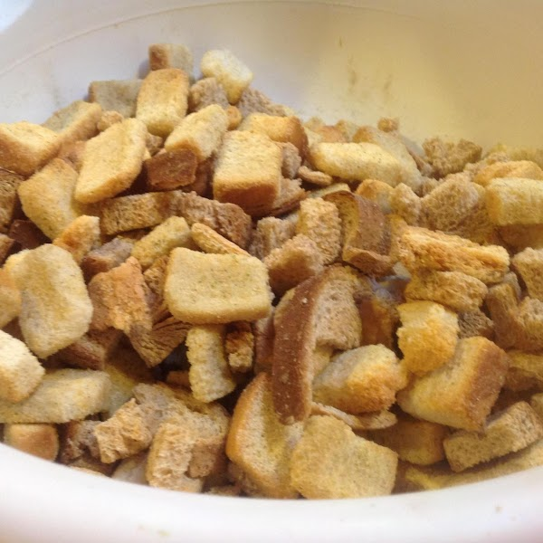 Add toasted bread cubes & salad croutons to a large bowl.