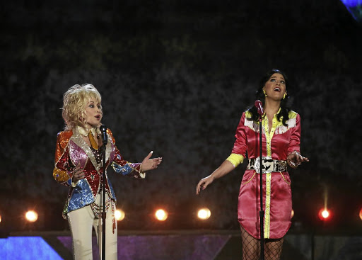Local content: While singers such as Dolly Parton, left, dominate broadcasts of country and western music in Africa, the continent's own artists in the genre need much more airtime. Picture: REUTERS