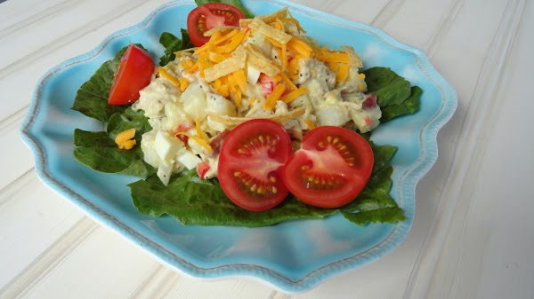 Serve on a bed of lettuce with or without the optional garnishes. Enjoy!!