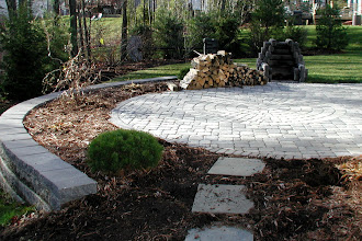 Photo: Roman Cobble Paving Stones w/ Circle Inlay (Antique Grey) Versa-Lok Sitting wall http://northernlightslandscapecontractors.com
