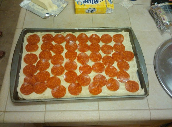 Preheat oven to 425 degrees. Butter a cookie sheet. An 18 X 13 should...