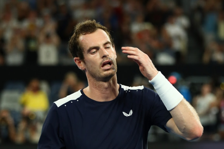 Andy Murray of Great Britain thanks the crowd after losing his first round match against Roberto Bautista Agut of Spain during day one of the 2019 Australian Open at Melbourne Park on January 14, 2019 in Melbourne, Australia.