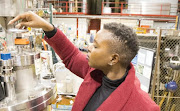Senamile Masango collecting data at Triumf Canada for her PhD experiment.