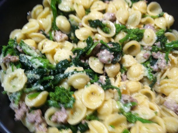 DRAIN THE PASTA N ADD TO SAUSAGE N BROCCOLI RABE...ADD 1/4 CUP OF PARMESEAN...
