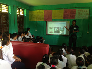 Photo: One of the roles of the Lab, as we envision it, is to promote local innovation in the community. Here, Shrijan is explaining the Solar Bottle Bulb, based on appropriate techonologies. Our hope is that the students will start thinking about how they can leverage available resources to promote innovation in their communities. They are not there, yet - but they will be... within a years' time.