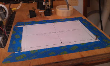 Photo: I used brad nails in the screw holes to line up the second template on the inside of the panel and taped in into place.  I then drilled out the corners of the section to be removed and used a jigsaw to cut between the drilled corners.