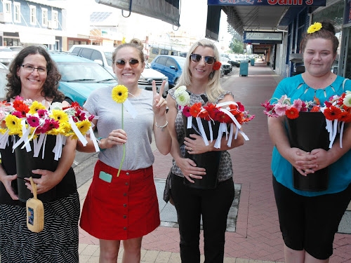 Lynette Murphy (Narrabri Homelessness Support Service, Jess Hawker and Renee Finnigan (Narrabri and District Community Aid Service) and Olivia O'Meara (NHSS) were among those who made for a welcome sight for passers-by as they handed out flowers along Maitland Street on Tuesday as part of Harmony Day.