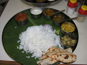 Photo: Thali or Meal(s) at the Maharaja Restaurant now called Suriyas on Triplicane High Road, Chennai. Served on a banana leaf. It is expected that you eat with hands (preferably your right) but on request they can find you a spoon or fork. Cost about 25 US cents.  Take short YouTube movie ride in a Tuk Tuk taxi along High Street where this eatery is http://www.youtube.com/watch?v=8Fa1ZC8cZdQ&feature=channel_page